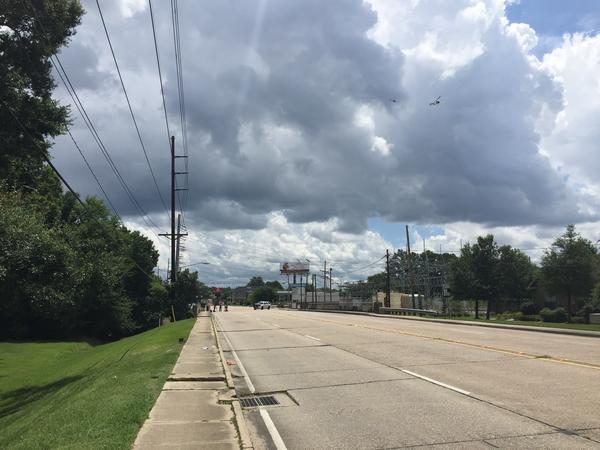 Old Hammond Highway has been shut down as authorities continue to investigate this morning's shootings of Baton Rouge police officers.