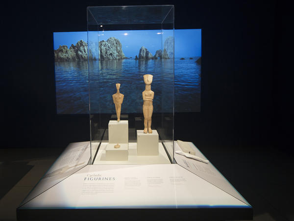 Three figurines from the Cycladic islands, which are roughly 5,000 years old, are on display at the National Geographic Museum.