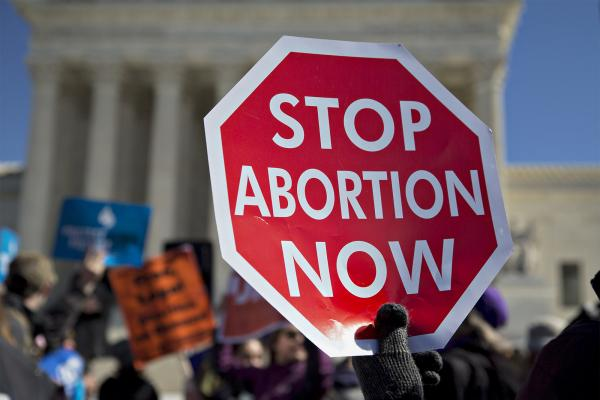 An anti-abortion demonstrator outside the U.S. Supreme Court in Washington, D.C., in March. Last month the high court struck down a Texas law that imposed tight regulations on abortion providers.