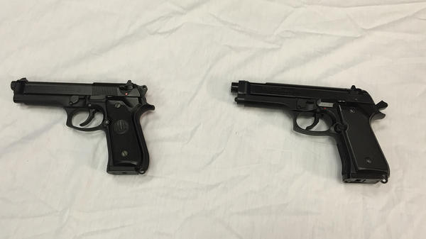 A Baltimore police officer shot and wounded a 14-year-old boy in April after spotting him with a Daisy Powerline 340 BB gun, right. At left is a semi-automatic handgun, pictured left, provided by police to show how similar the models look.