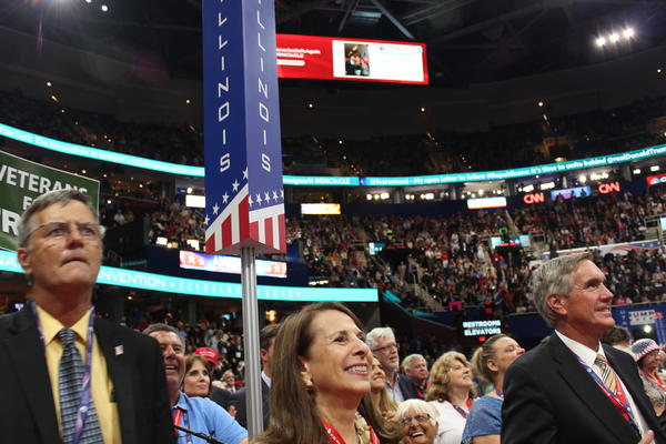 Illinois Republican National Committeewoman Demetra Demonte and state party chairman Tim Schneider on the floor for the first night of the Republican National Convention in Cleveland.