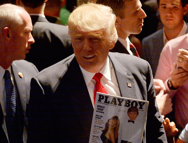 Republican presidential nominee Donald Trump shows a police officer his photo on the cover of a <em>Playboy</em>magazine during a campaign event at the Duke Energy Center for the Performing Arts on July 5 in Raleigh, N.C.