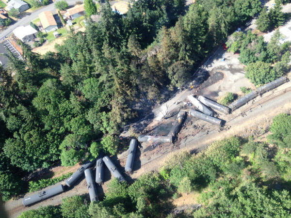 <p>An overhead shot of the wreckage from an oil train derailment and fire in Mosier, Ore., on June 4, 2016, the morning after the crash.</p>
