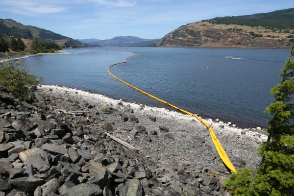 <p>Emergency crews on June 4, 2016, found an oil sheen on the bank of the Columbia River near the site of an oil train derailment and spill in Mosier, Oregon, the day prior.</p>