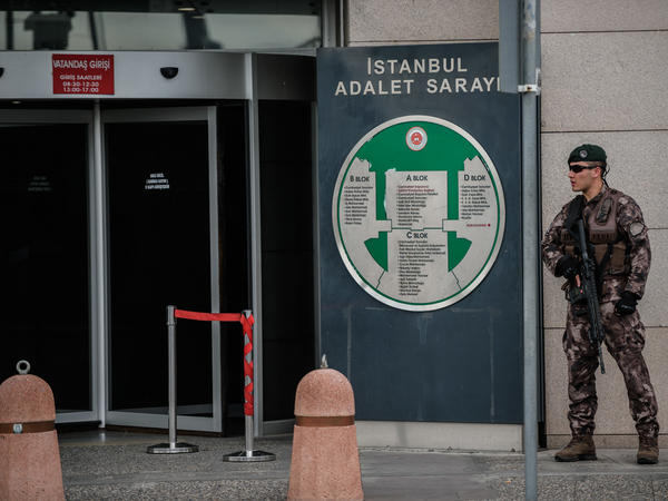 A Turkish special forces police officer stands guard in front of the Istanbul Justice Palace on July 20. Family members of those detained have been gathering outside, hoping for a chance to see their loved ones.