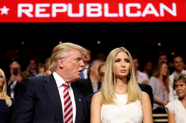 Republican presidential candidate Donald Trump speaks to his daughter, Ivanka, during Wednesday evening's convention events.