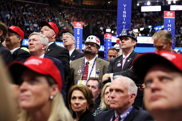 Delegates listen to Ivanka Trump's speech from the convention floor.