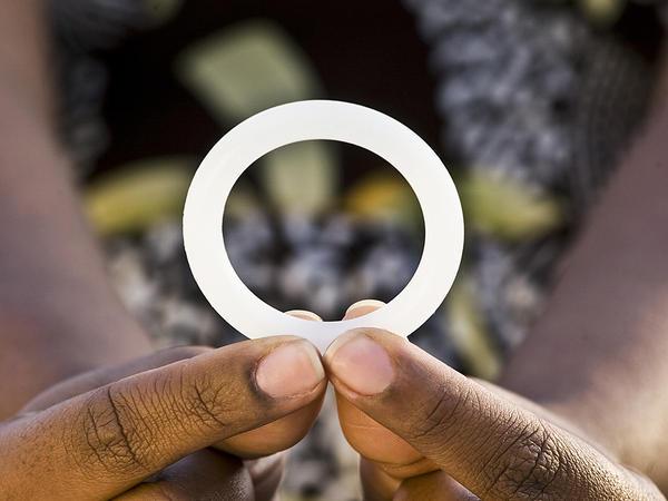 Woman holding the dapivirine vaginal ring.