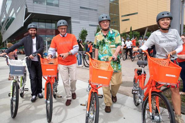 <p>Nike VP of Global Community Impact Jorge Casimiro, Mayor Charlie Hales, U.S. Rep. Earl Blumenauer and Nancy Hales take off on BIKETOWN's first inaugural ride across Tilikum Crossing.</p>