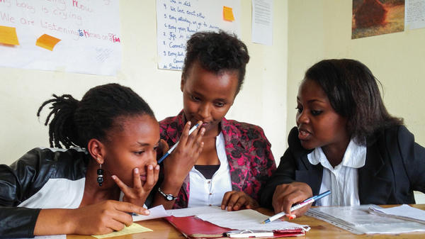 Akilah debate team members (from left) Phylis Kabano, Sonia Rugwiro and Mireille Umutoni Sekamana prepare to compete in a debate tournament.