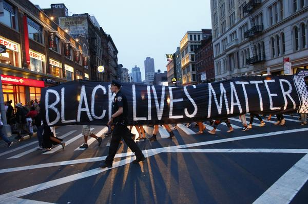 A police officer patrols during a protest in support of the Black Lives Matter movement in New York City on July 9.