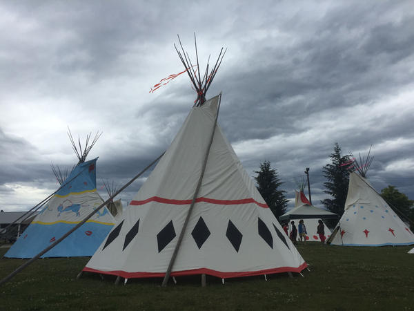 A circle of traditional Teepees stands nearby the arena. The modern-day powwow is a cultural celebration.