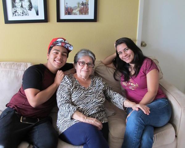The Ruiz family, Andres Ruiz, Ligia Zarate and Carolina Ruiz, of Tampa, share their experiences in learning English.
