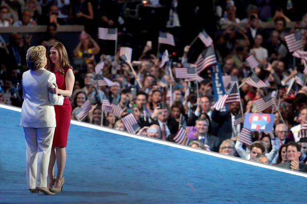 Democratic presidential nominee Hillary Clinton embraces her daughter Chelsea Clinton after being introduced on the fourth day of the Democratic National Convention.