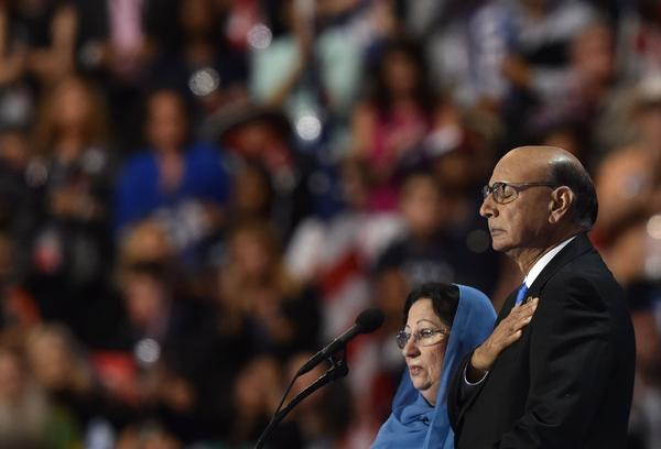Khizr Khan, father of Humayun S. M. Khan, who was killed while serving in Iraq with the US Army, gestures as his wife looks on during the fourth and final day of the Democratic National Convention.