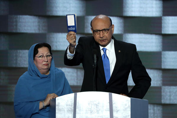 Khizr Khan, father of deceased soldier Humayun S.M. Khan, holds up a copy of the U.S. Constitution as he delivers remarks on the final day of the convention.