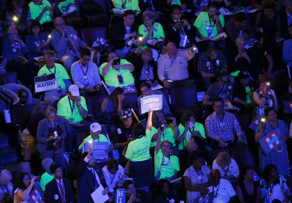 Bernie Sanders supporters wear bright shirts on the final day of the Democratic National Convention.