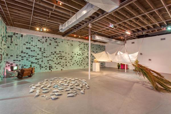The Locust Arts Builders' installation includes lawn flamingos cast in concrete.