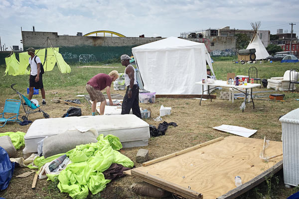 "Volunteers dismantle the ""Clintonville"" campsite on the last day of the Democratic National Convention."