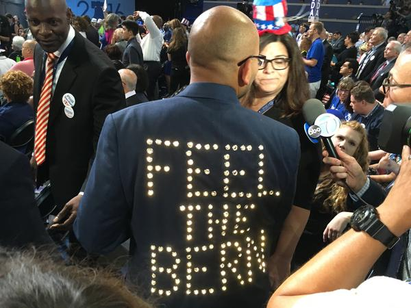 "A Bernie Sanders delegate sports a ""Feel the Bern"" jacket at the Democratic National Convention."