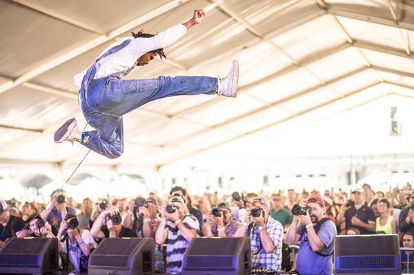 Raury gets some serious air during his Friday-afternoon set at the Quad Stage.