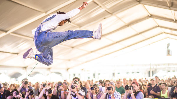 Raury gets some serious air during his Friday-afternoon set at the 2016 Newport Folk Festival.
