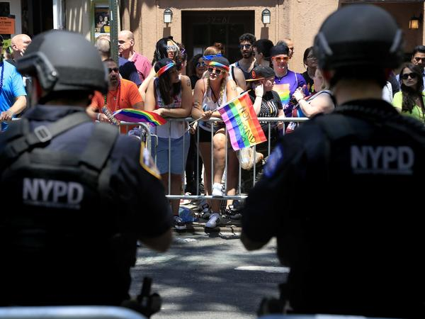 Heavily armed police officers watch over the crowds at the NYC Pride Parade in New York on June 26.
