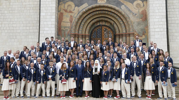 Russian Olympians, along with coaches and other officials, pose outside the Assumption Cathedral in Moscow on Wednesday before heading to Brazil. Russia had planned to send nearly 400 athletes to the Rio Games, but more than 110 have been banned because of a doping scandal.
