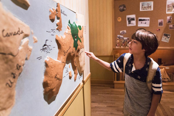 Aiden Hunter, 9, looks at a map of Europe to learn more about where the Holocaust took place in the children's exhibit at the United States Holocaust Museum in Washington D.C. The Museum has an interactive children's exhibit that uses the fictional story of a boy named Daniel to teach children about the Holocaust.