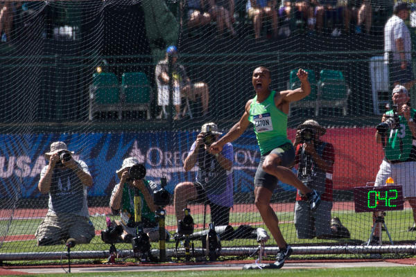 Defending Olympic decathlon gold medalist Ashton Eaton of Eugene lets out a yell to urge on his discus during the U.S. Olympic Trials.