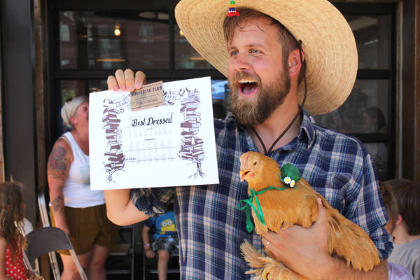 Cale Whicker, with Miss Felicia Fancy Feet, displays their award for the competition's best-dressed chicken.