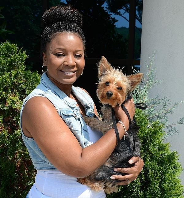 Kim Headen fills orders in the warehouse at Replacements Ltd. and brings her Yorkshire terrier, Charlie, to work. The company currently has 400 employees and 30 animals that come to work.