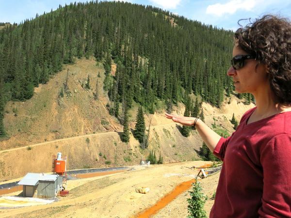 Joyel Dhieux, EPA on-scene coordinator, looks at an old water treatment plant that stopped operating near the base of the Gold King Mine in the early 2000s. The EPA built its own temporary plant in October 2015 after the Gold King Mine spill.