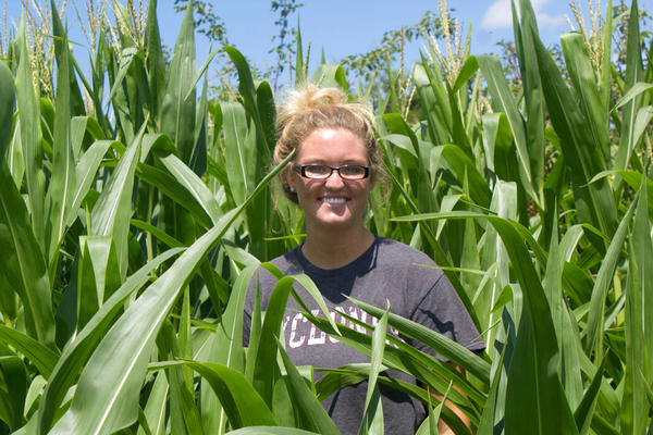 Pictured in the corn fields of the student-managed farm she helped run this summer, Taryn Riediger is an aspiring farmer. After graduating, she expects to work livestock for someone else before possibly returning to her family's farm.