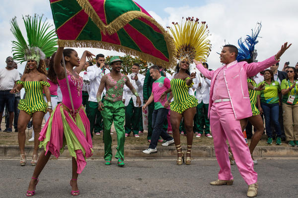 Dancers from the Mangueira samba school perform in the street Thursday while waiting for the arrival of the Olympic flame ahead of the games, which open Friday in Rio de Janeiro. The flame will be carried through the streets of Rio to Maracana Stadium for Friday night's opening ceremony.