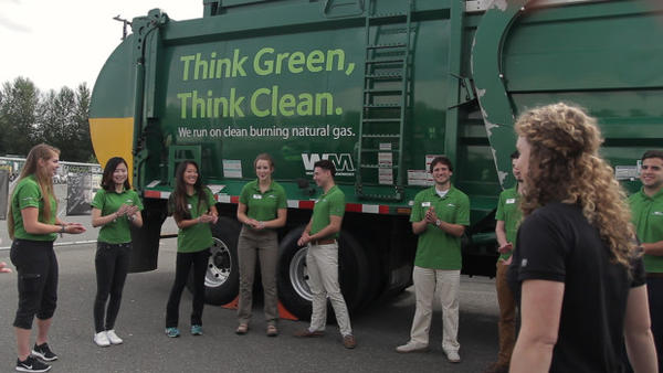 <p>Waste Management interns gather for a brief meeting at the Auburn Waste Management facility before heading out to the complexes they will be canvassing.</p>