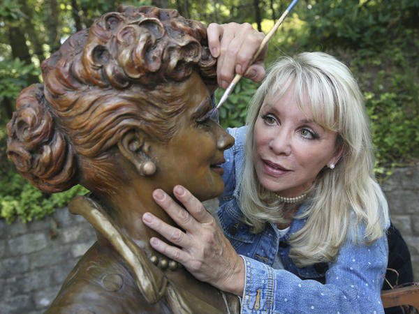 Artist Carolyn Palmer works on the replacement Lucille Ball statue.