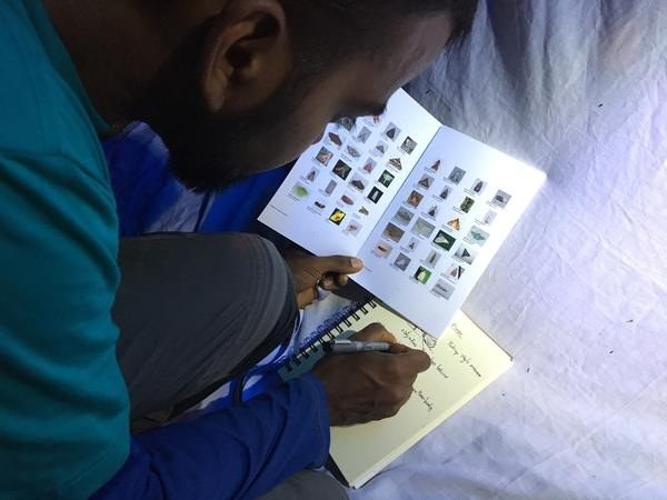 Stalin Murugesapandi takes photos and makes field sketches to record the different insect species he sees.