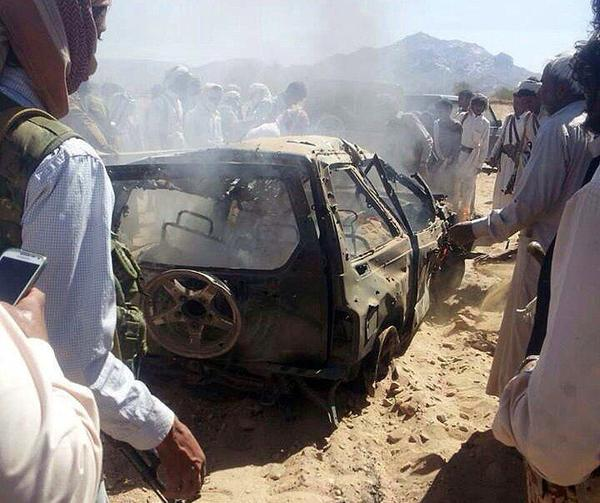 Yemenis gather around a burnt car after it was targeted by a drone strike killing three suspected al-Qaida militants in January 2015.
