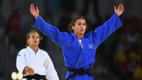 Kosovo's Majlinda Kelmendi celebrates winning the gold medal over Italy's Odette Giuffrida in the women's 52-kilogram (114-pound) weight class. This is Kosovo's first time at the Olympics, and Kelmendi's victory marked its first medal.