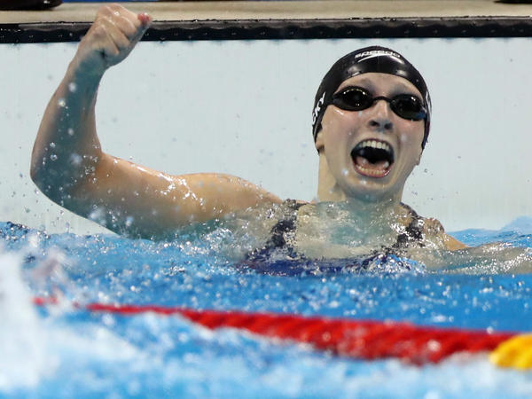 United States' Katie Ledecky celebrates winning the gold medal in the women's 400-meter freestyle, setting a world record during the swimming competitions Sunday at the Summer Olympics in Rio de Janeiro.