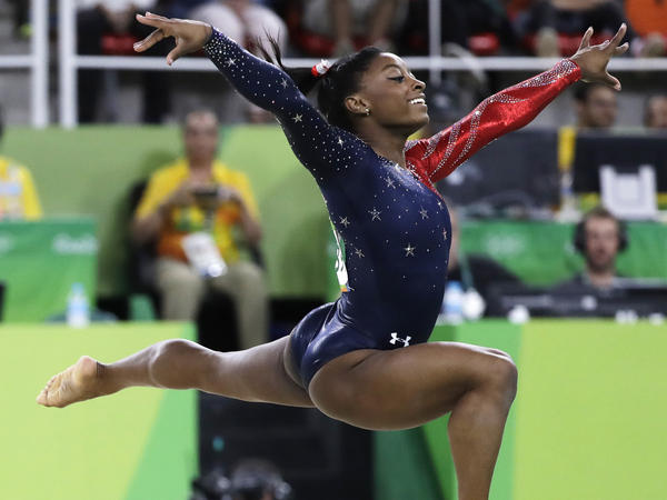 United States' Simone Biles performs on the floor during the artistic gymnastics women's qualification Sunday.