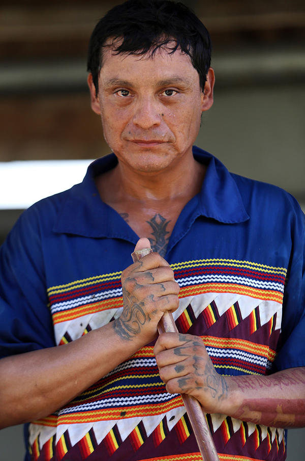 Joe Osceola, 40, wears a traditional Seminole Patchwork shirt while herding cattle at the weigh station at Brighton.