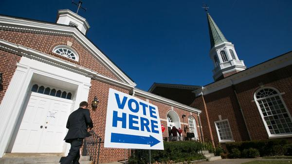 Voters turn out to cast their ballots for the midterm election at First Christian Church of Decatur, Ga., in 2014.