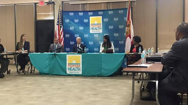 Gov. Rick Scott presides over a Duval County Zika roundtable with Jacksonville Mayor Lenny Curry in June.