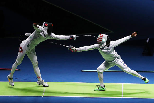 Jason Pryor of the United States (right) in action against Benjamin Steffen of Switzerland during the Men's Epee at the Summer Olympics.
