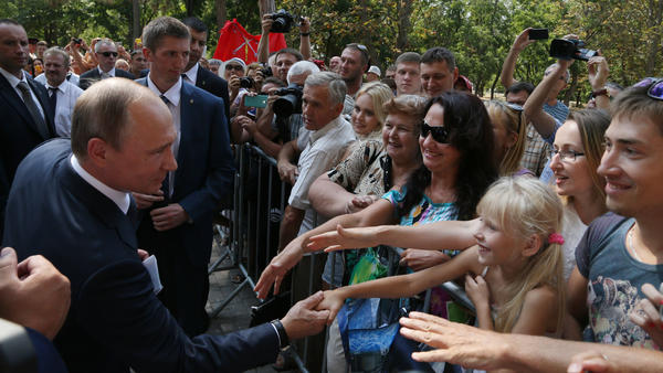 Russian President Vladimir Putin greets well-wishers on a visit to Crimea in August 2015. Russia seized and annexed the territory from Ukraine in March 2014.