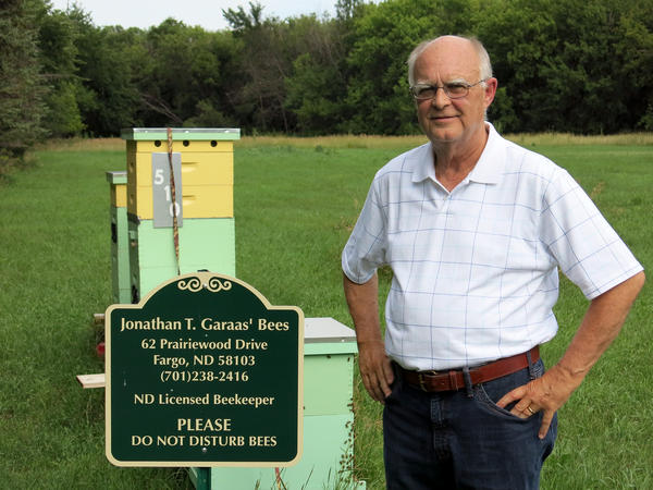 Attorney and hobby beekeeper Jonathan Garaas keeps nine thriving hives outside of Fargo, N.D.