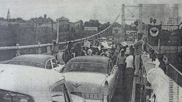Farmworkers on strike block traffic on the Roma bridge in Roma, Texas, in 1966.