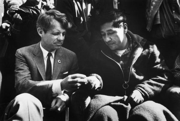 Sen. Robert F. Kennedy shares bread with Chavez on March 10, 1968, as the union leader ends a 25-day fast in support of nonviolence in the strike against grape growers.